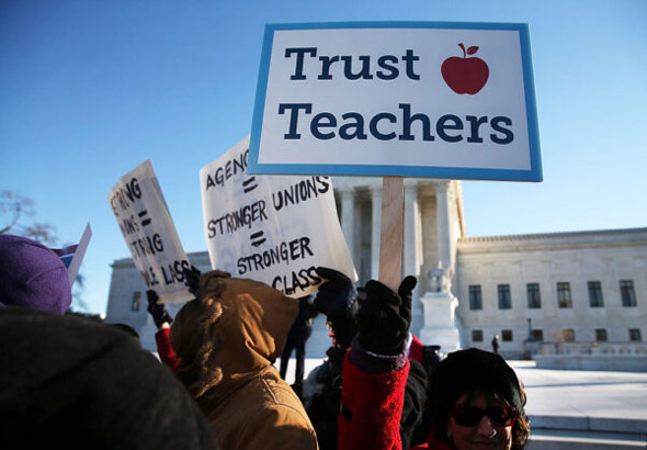 california teachers association supporters protest in front of the u s  supreme court in washington  d c