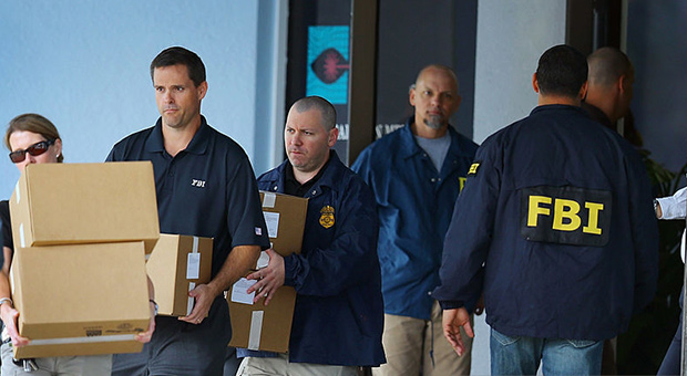 fbi agents were seen carrying boxes and evidence from the offices following the raids