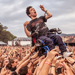 Rock Fan With Cerebral Palsy Crowd Surfs in Wheelchair at Music Festival
