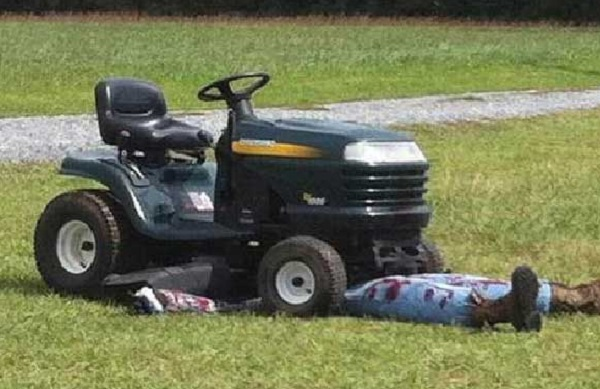 graphic lawnmower accident halloween decoration prompts 911