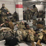 Over 100 National Guard Troops Contract COVID After Sleeping In Parking Garage