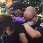 Photo of Protester and Police Officer Praying Together Goes Viral