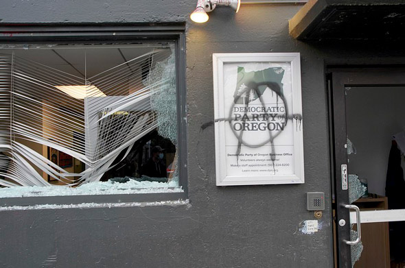 antifa mobs attacked the democratic party headquarters in portland and covered the building in anti biden graffiti