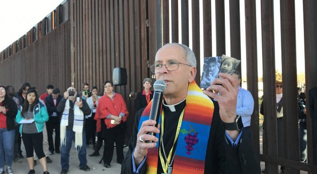 the bishop prayed and walked a honduran family of five across the border bridge to make a claim