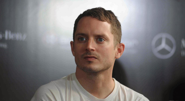 elija wood has exposed the powerful figures that operate within hollywood s elite