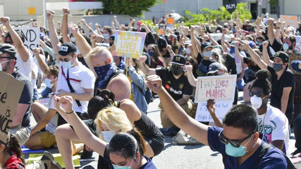 black lives matter supporters are already bowing in submission to the marxist group s agenda