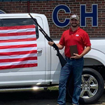 Car Dealership Offering Free Bible, Shotgun, and Flag for 4th July Customers