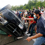 Oklahoma Gov Signs Bill to Protect Drivers Who Hit Rioters with Their Vehicle