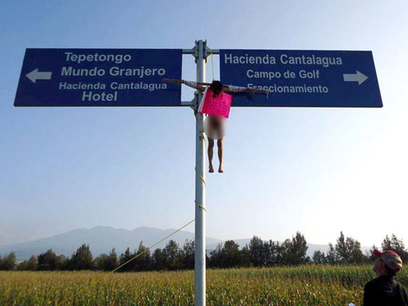 http://www.neonnettle.com/news/images/pedophile-crucified-on-road-sign-set-free-by-police-2161217.jpg