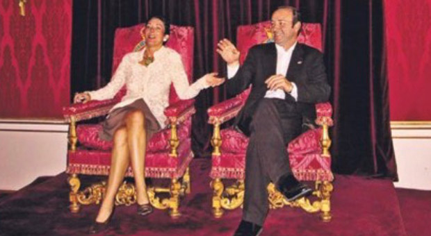 ghislaine maxwell is pictured sitting in the throne alongside disgraced actor kevin spacey