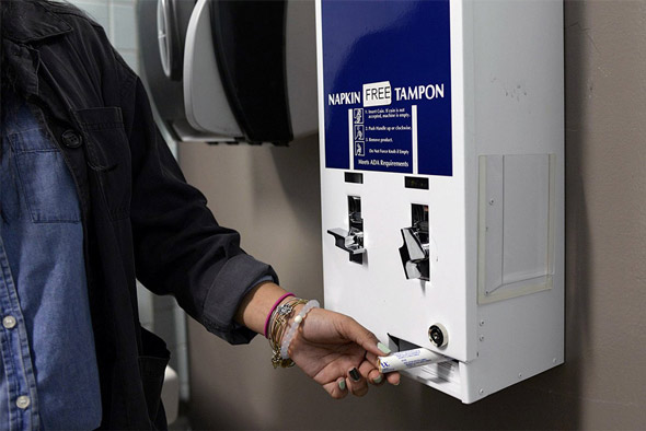 university officials aim to place tampon dispensers in all bathrooms  including the men s