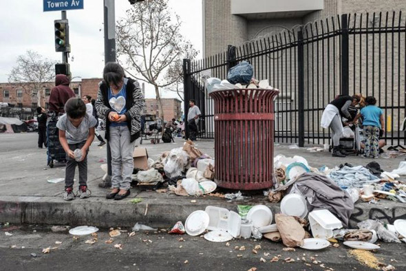 children fend for scraps in the trash that litters los angeles  slums