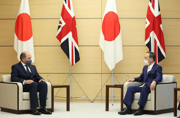 ben wallace met japanese prime minister yoshihide suga in tokyo to discuss the uk s military plans