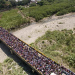 Thousands Flee Venezuela As Country's Economic Crisis Explodes