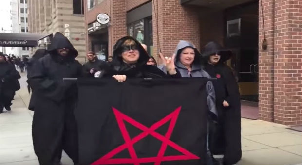 a group of satanists was caught marching in protest against president donald trump